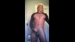 blond guy strokes his big black cock
