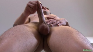 dreamy ripped stud jerks his cock
