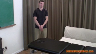 tall straight boy gets his first massage from a man
