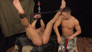 Viktor Adam is shackled and gagged in the dungeon