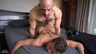 Austin Wilde bareback fucks Logan Cross