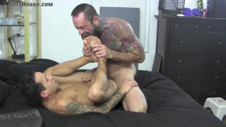 top sucks his bottom's toes during fuck session