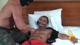 muscle stud David Rome tied to the bed
