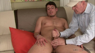 guy watches straight porn while old man gives him handjob