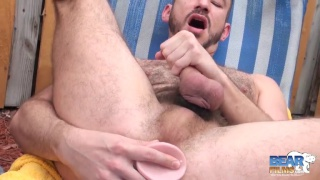Owen Powers stuffs a dildo in his hole