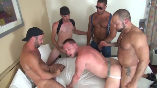 Hans Berlin rents a hotel room for a gang bang