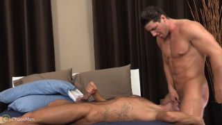 sean sucks his buddy's dick over edge of the bed