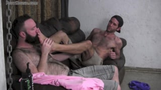 buster licks the cum off landon's feet