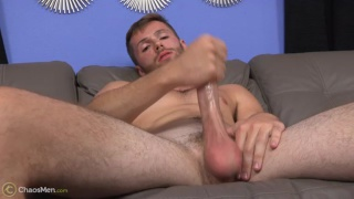 bearded stud strokes his long cock