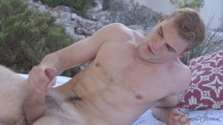 hunky blond jerks off outside