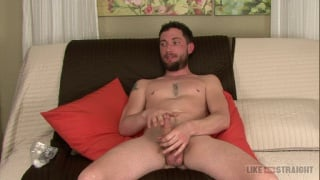 handsome bearded guy strokes his cock