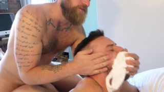 bearded top fucks his younger buddy
