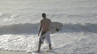 sexy surfer heads indoors to jerk off