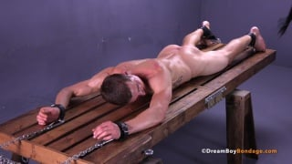 jared gets flogged on the wooden rack