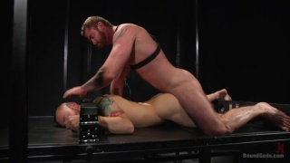straight bearded man serves in gay master's dungeon