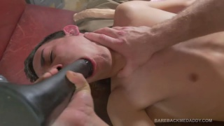 guy sucks on dildo before daddy fucks him with it