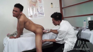 asian doctor gives his twink patient an anal exam