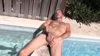 hairy man jacks off poolside