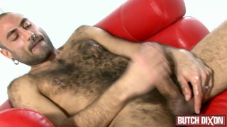 very hairy guy jerks his fat cock