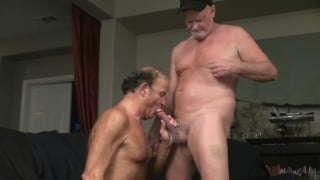 old man on his knees blowing his masseur