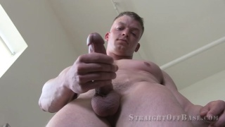 blond sergeant strokes his big cock