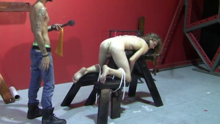 slave boy tied to a whipping bench