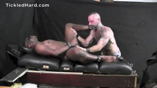 beefy football player tied down and tickled