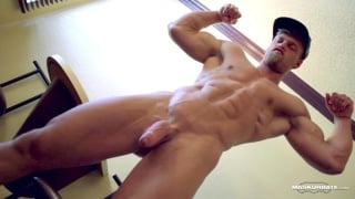 muscle hunk strips naked and strokes his huge tool