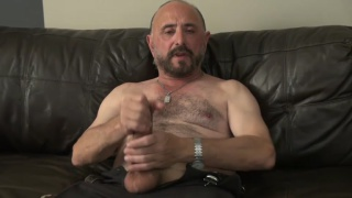 hairy-chested daddy jerks his monster cock