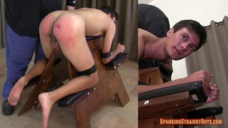 dark-haired guy strapped into the spanking bench