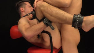 Romi Zuska has Adam Rezal gagged and shackled to a chair