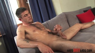 boxer and personal trainer jerks his big uncut cock
