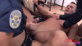 3 female prison guard use a guy