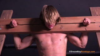 blond guy finds himself in wooden stockades