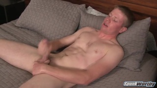 blond guy strokes his long skinny cock