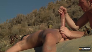 nkaed guy roped to a massive pipe and wanked