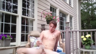 young guy plays with his fleshjack outdoors