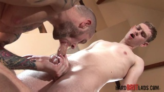 heavily-inked muscle hunk fucks blond twink