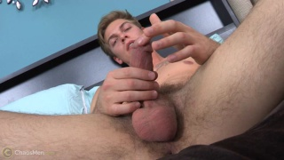 blond guy plays with his precum
