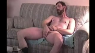 bearded redneck jerks off in cowboy boots