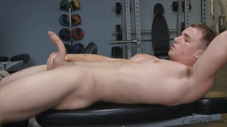 blond muscled eli strokes his long dick