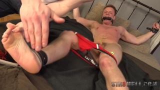 bound euro boy gets his ass and feet spanked