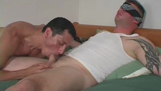 blindfolded beefy dude gets his dick sucked