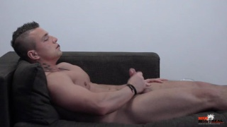 sexy guy jerks off with a sex toy