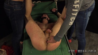 naked Tomas Fuk gagged and shackled to the bed