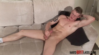blond brit Liam Lawrence jerks his uncut cock
