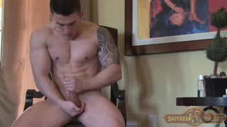 good-looking chiseled guy jerks his cock