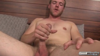 blond scruffy-face topher jerks his cock