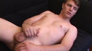 gorgeous guy works his slippery cock and fingers his ass