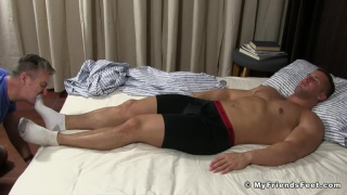 sleeping hunk gets his feet worshipped